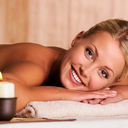 Close-up portrait of a beautiful smiling female lying down in beauty salon